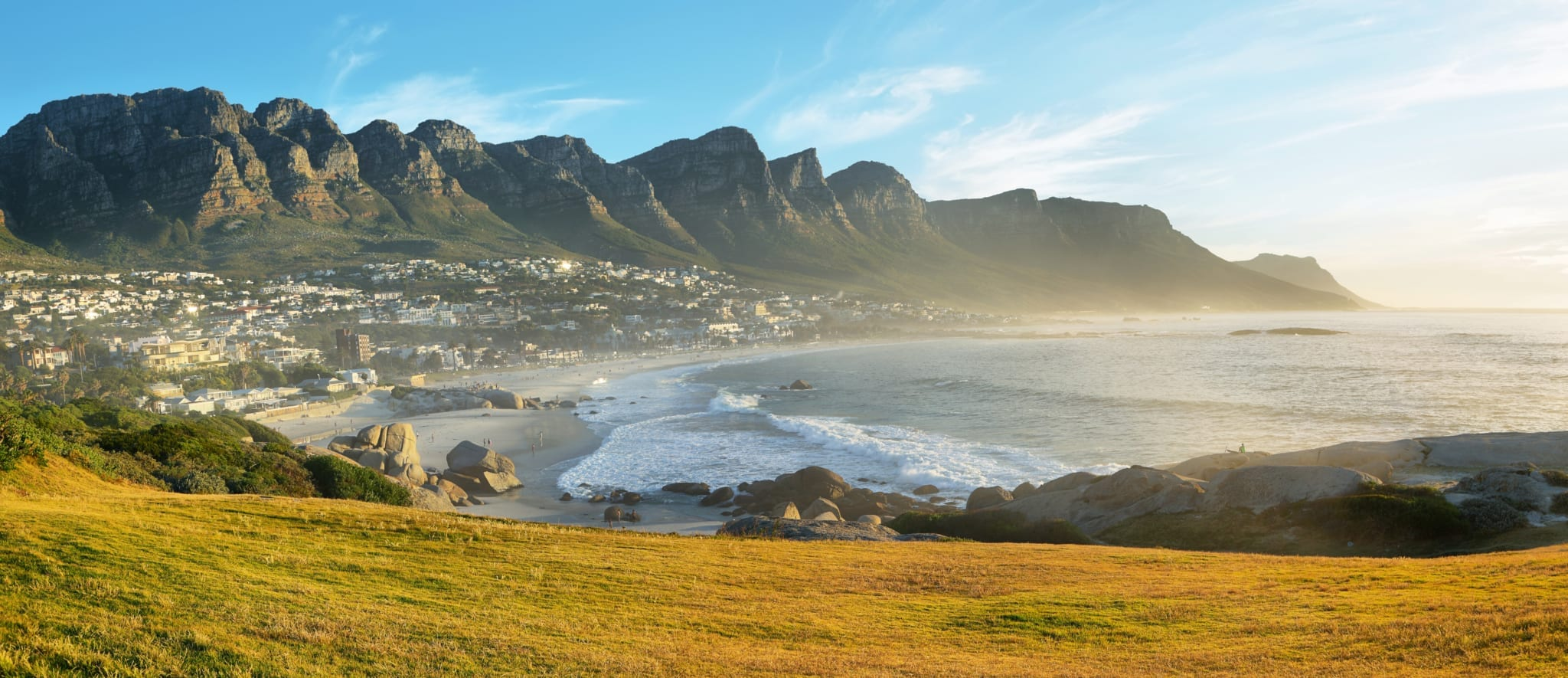 Camps Bay Beach in Cape Town, South Africa, with the Twelve Apostles in the background.