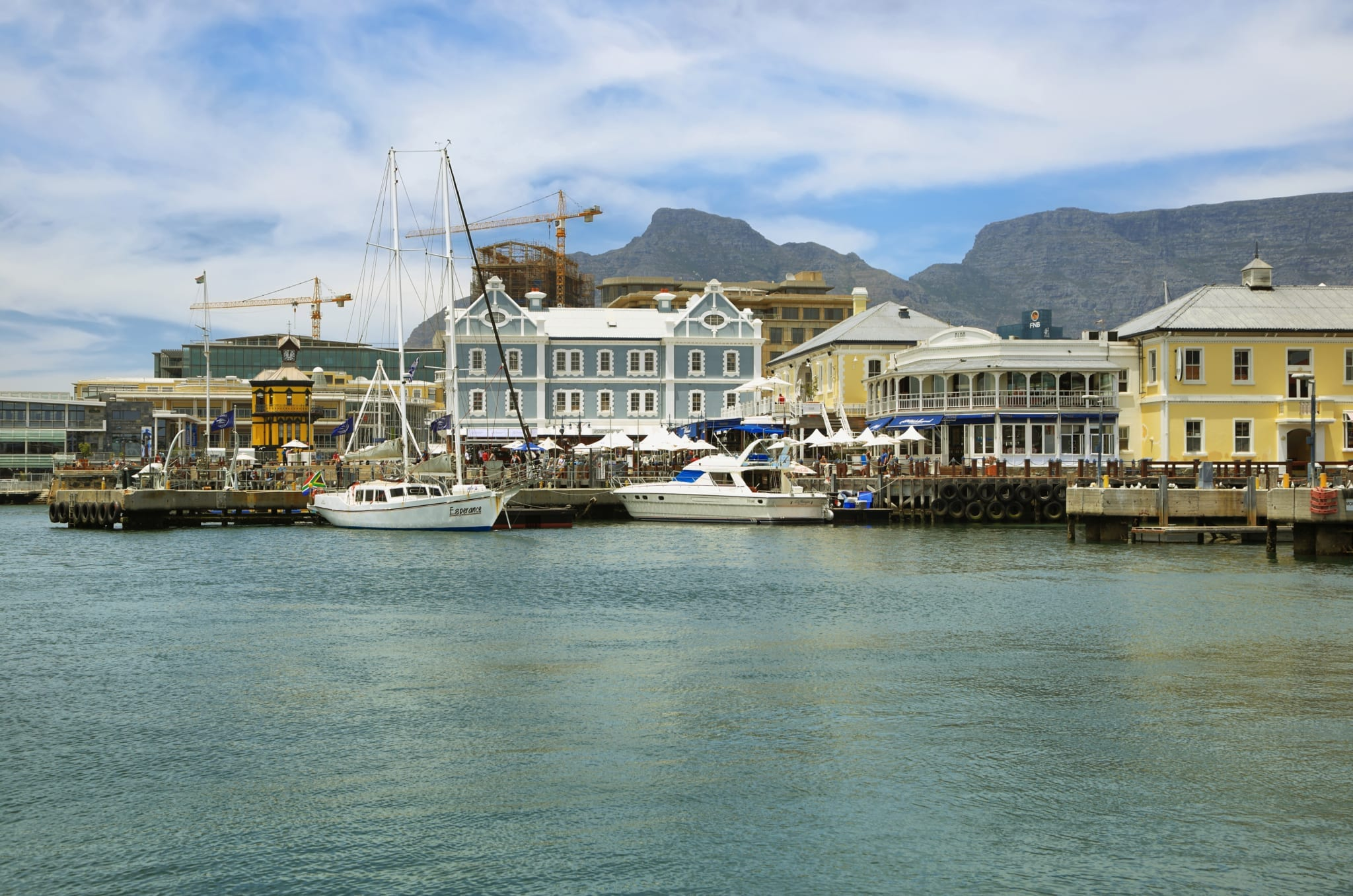 CAPE TOWN,SOUTH AFRICA-DECEMBER, 29:Victoria and Alfred Waterfront, harbor with recreation boats, shops, restaurants and Table Mountain on background on December 7, 2014  in Cape Town, South Africa.